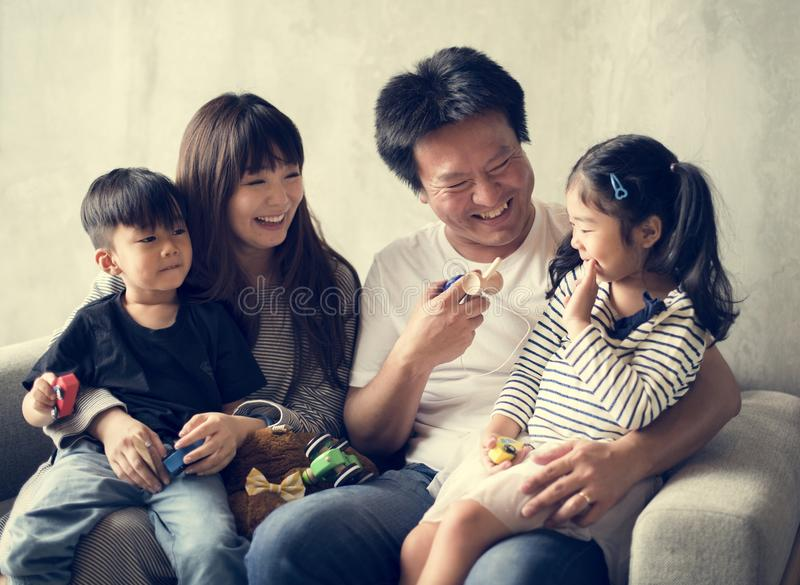 Happy Japanese family at home royalty free stock image