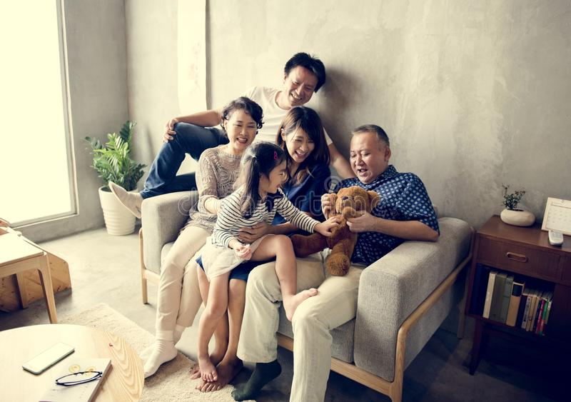Happy Japanese family relaxing at home stock images