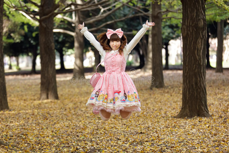 Happy japanese lolita. Cosplay jumping in harajuku park, Tokyo stock images