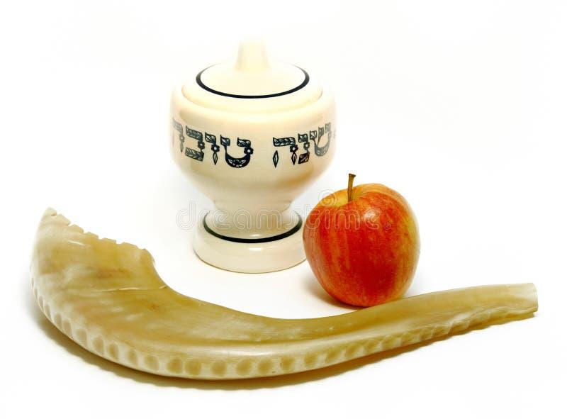 Happy Jewish New Year. Symbols of Jewish New Year, honey pot, apple, ram's horn royalty free stock image