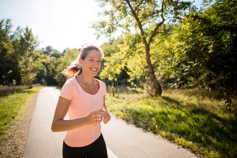 Happy jogging in park stock image