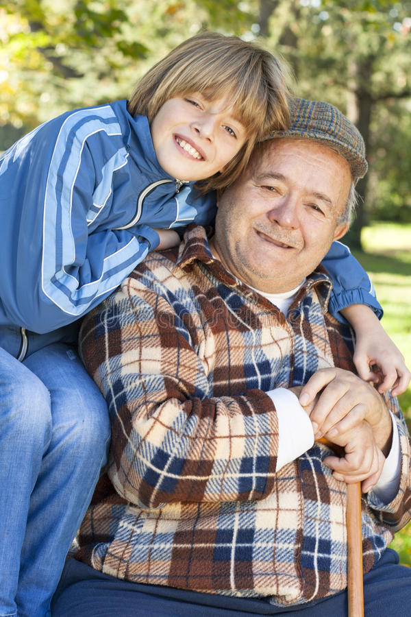 Happy and jolly grandfather and grandson royalty free stock photos