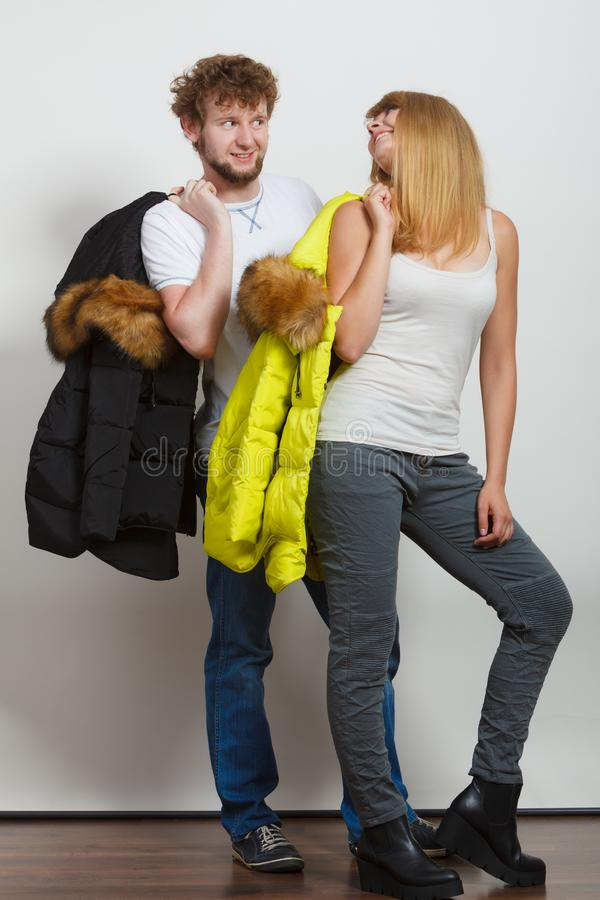 Happy couple man and woman with fashion jackets. royalty free stock photography
