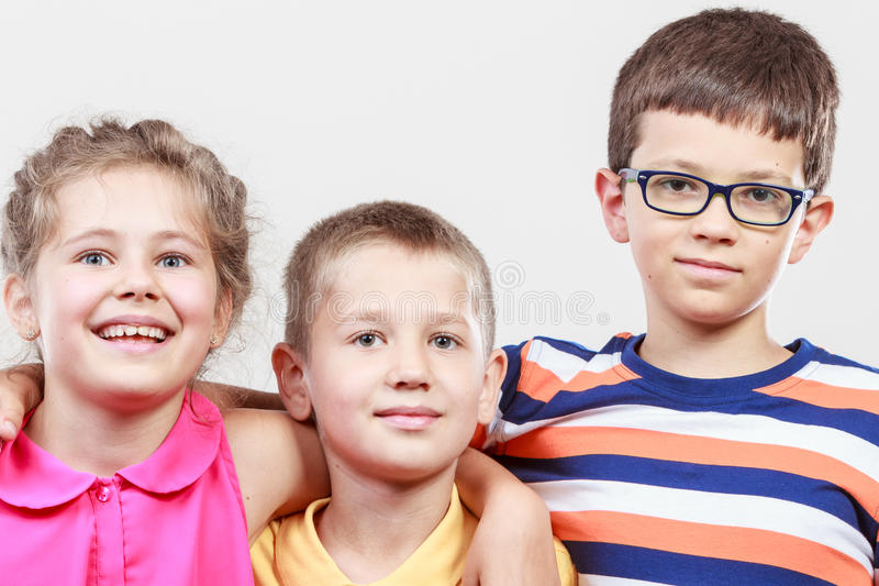 Happy joyful cute kids - little girl and boys. royalty free stock photography