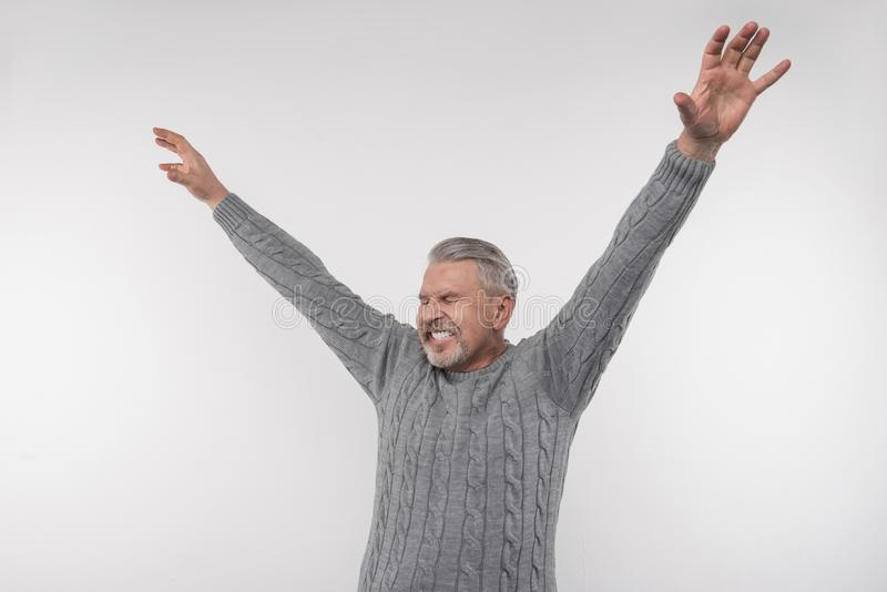 Joyful emotional man expressing his happiness royalty free stock photography