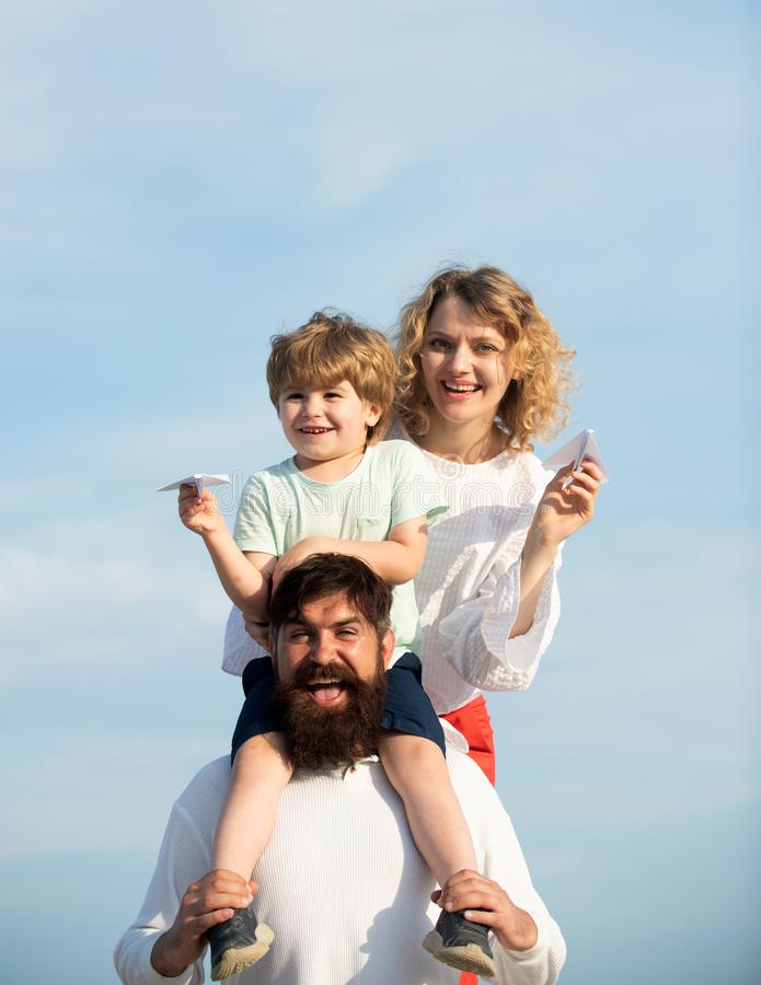 Happy joyful family having fun throws up in the air little boy child. Happy family with kid on summer field - dream of. Flying concept. Happy family on holiday stock photo