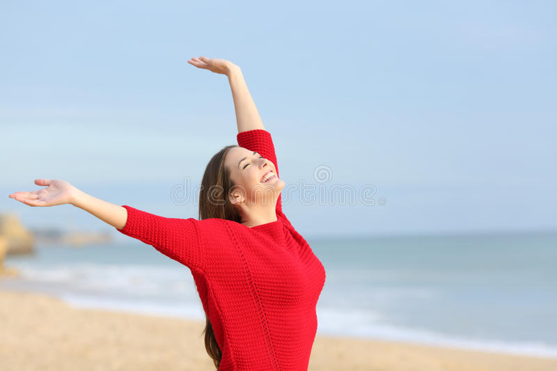 Happy joyful woman excited in the beach royalty free stock image