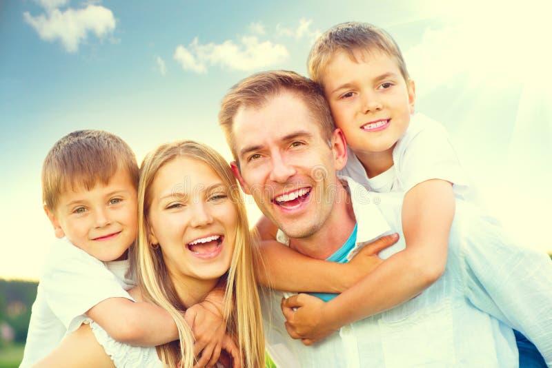 Happy joyful young family. Having fun in summer park royalty free stock image