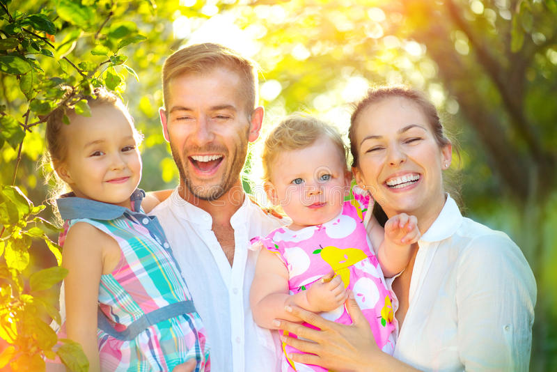 Happy joyful young family with little kids outdoors stock photo