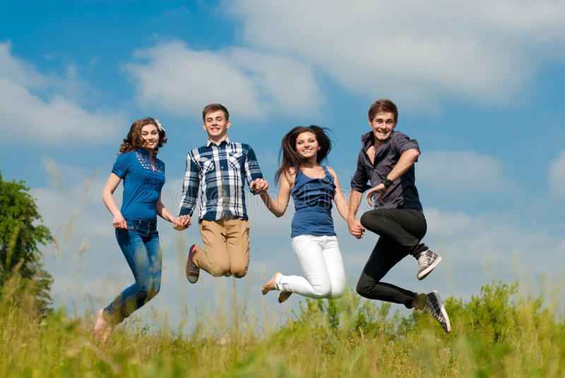 Happy jump: group of Young people outdoors royalty free stock images