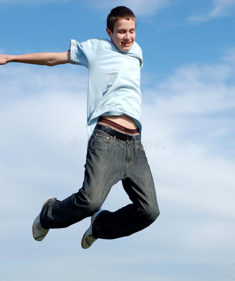 Happy jumping boy stock images
