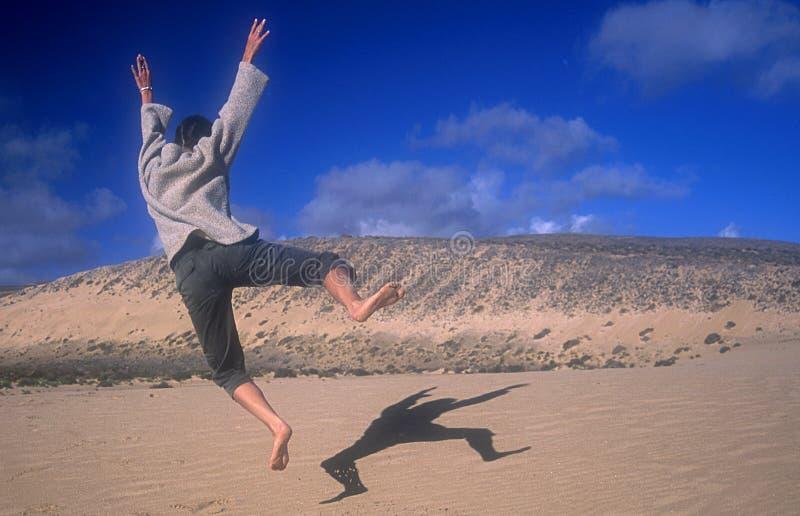 Happy Jumping girl stock photos