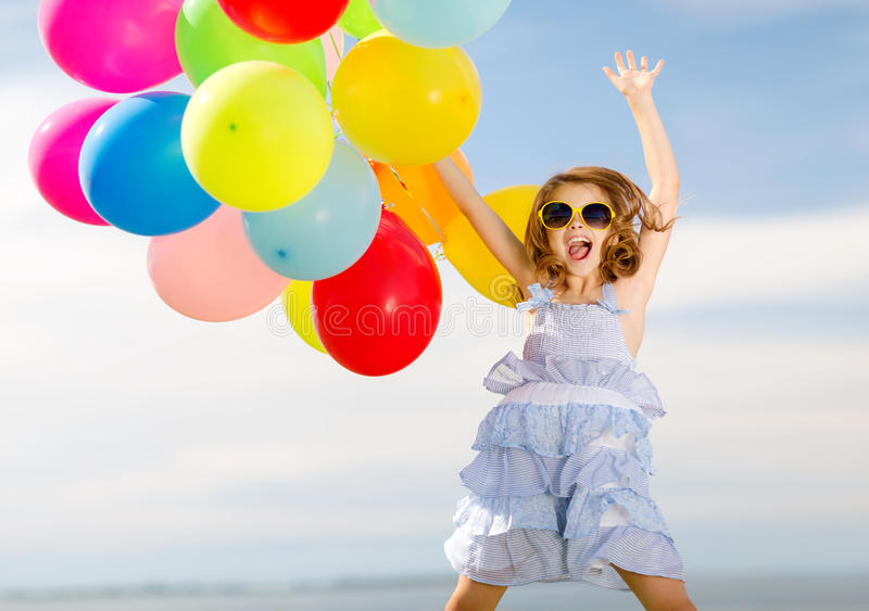 Download Happy Jumping Girl With Colorful Balloons Stock Image - Image: 40042277