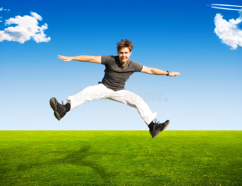 Happy jumping man stock image
