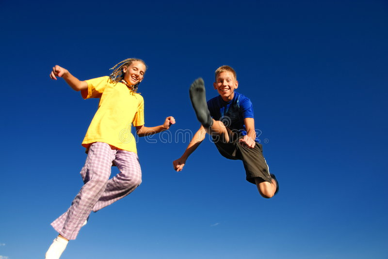 Download Happy jumping teens stock image. Image of green, spring - 3649911