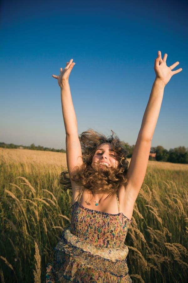 Happy jumping woman royalty free stock photos