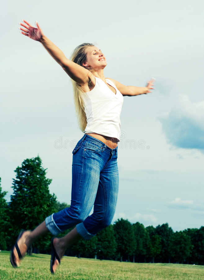Free Happy Jumping Woman. Royalty Free Stock Image - 5584156