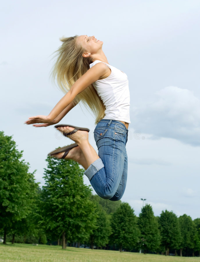 Free Happy Jumping Woman. Royalty Free Stock Image - 5661266