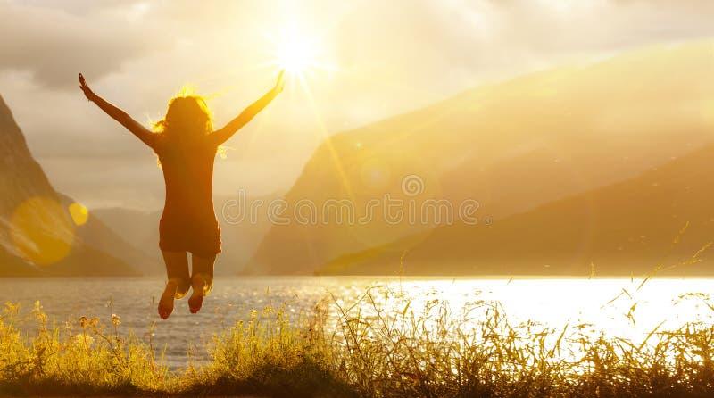 Happy Jumping woman at a lake stock photos