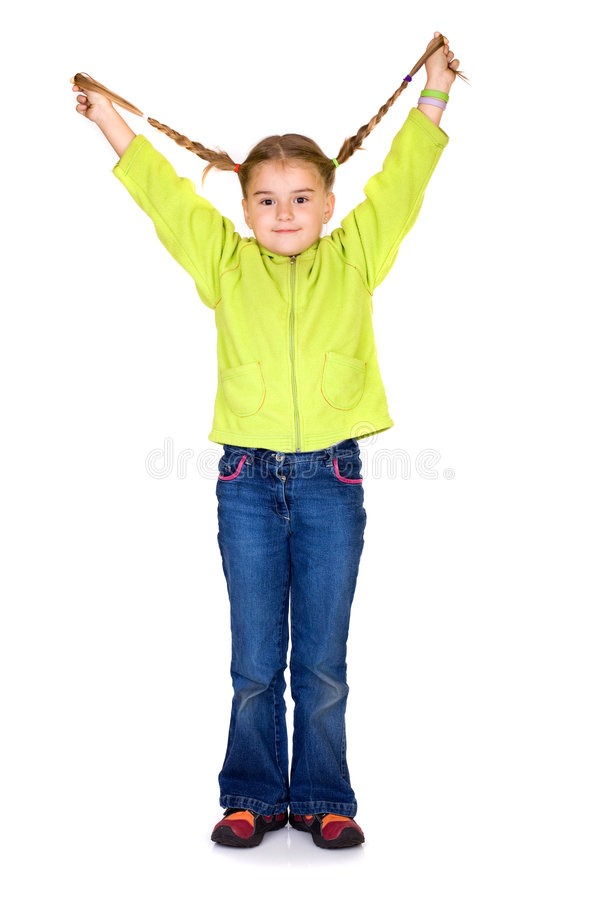 Happy kid. Happy 5 years old girl playing with her hairstyle royalty free stock photos
