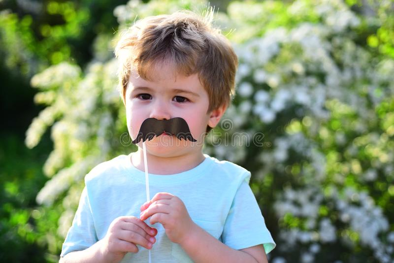 Happy kid in blooming nature. spring holiday. Sunny weather. Childhood happiness. Childrens day. Little boy child in royalty free stock photo