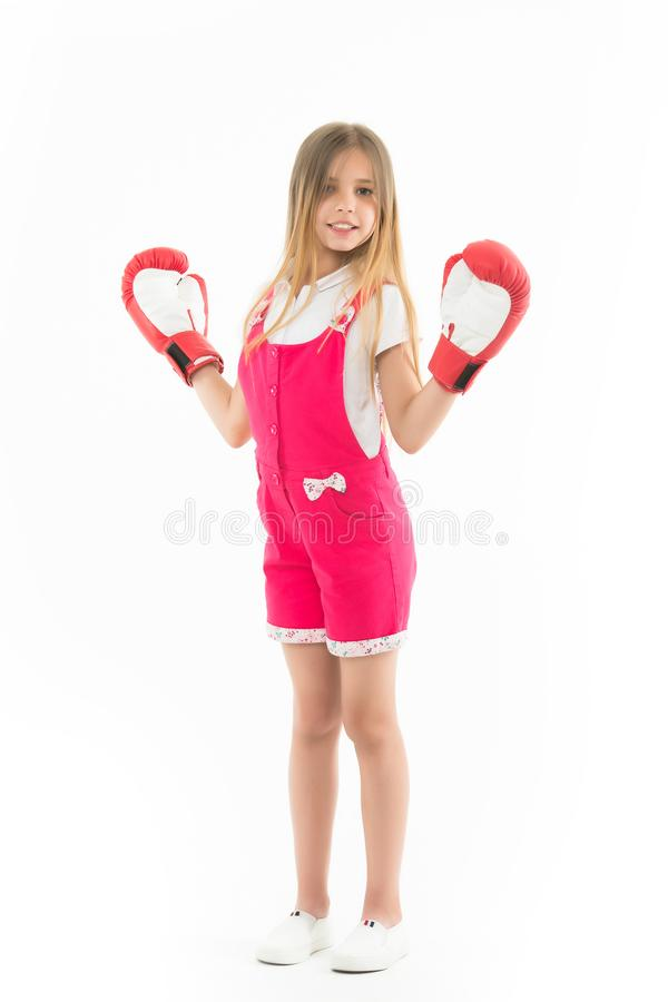 Happy kid in boxing gloves isolated on white. Little girl smile after boxing trainings. Punching. Childhood development. And health. Child boxer show power. I royalty free stock images