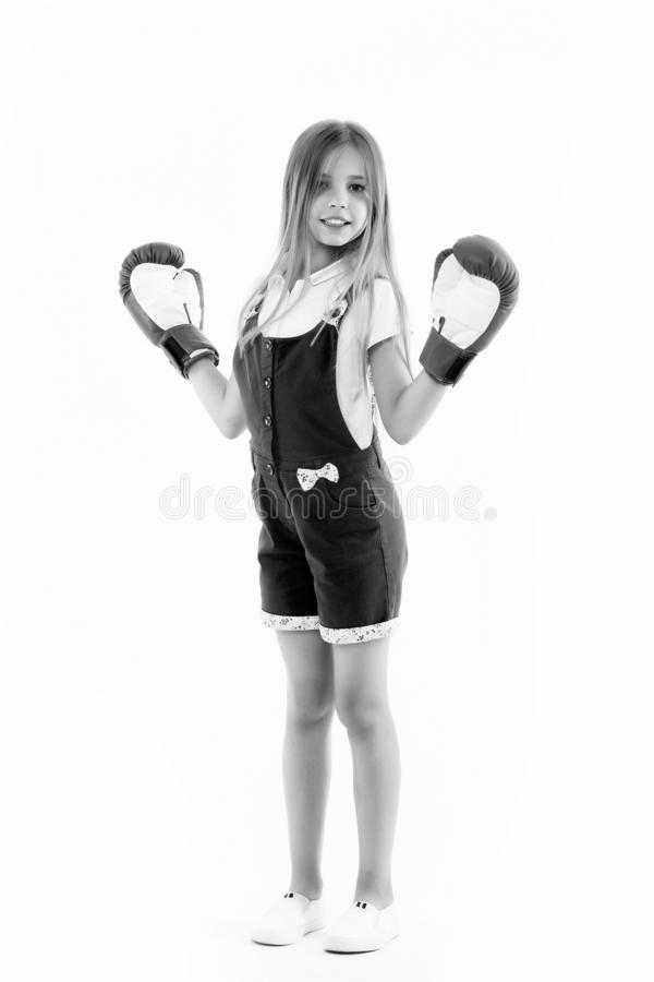 Happy kid in boxing gloves isolated on white. Little girl smile after boxing trainings. Punching. Childhood development. And health. Child boxer show power. I stock image