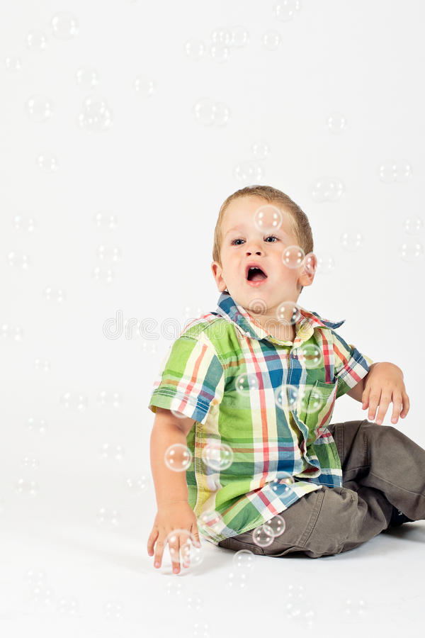 Download Happy kid with bubbles stock photo. Image of expression - 16576572