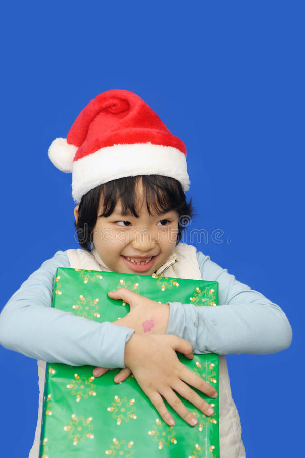 Happy kid with Christmas gift royalty free stock photography