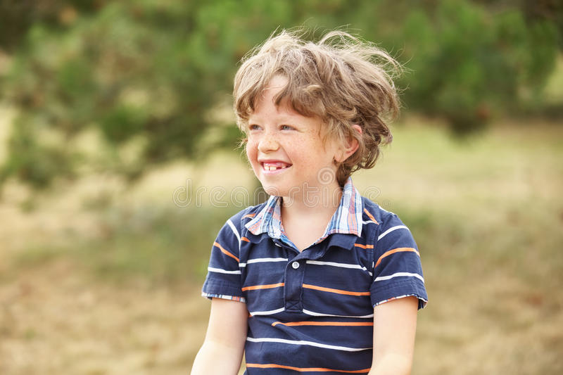 Happy kid with freckels royalty free stock photos