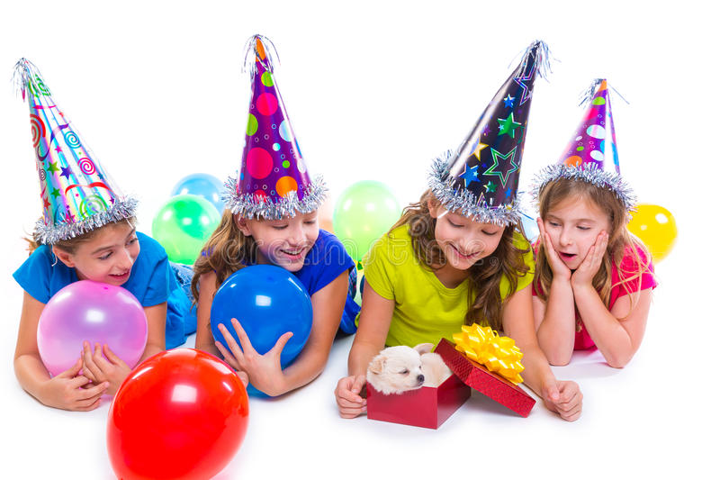 Happy kid girls puppy dog gift in birthday party. Balloons on white background stock image