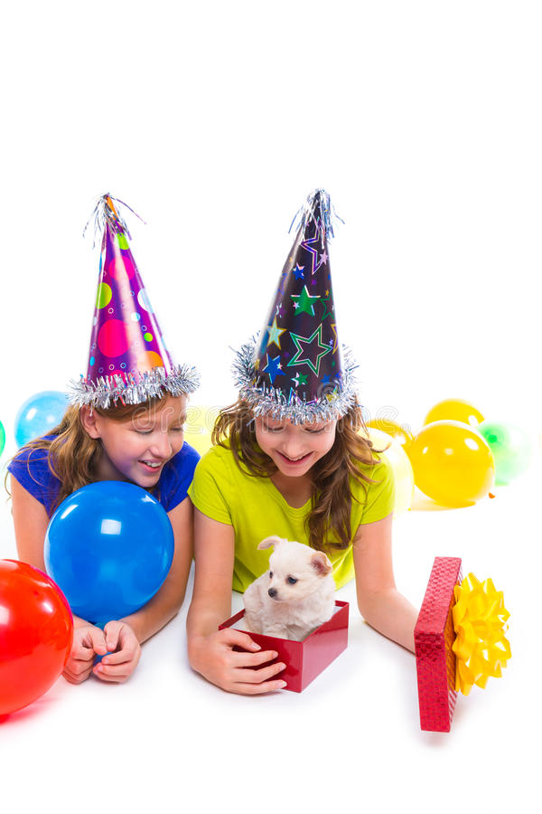 Happy kid girls puppy dog gift in birthday party royalty free stock image