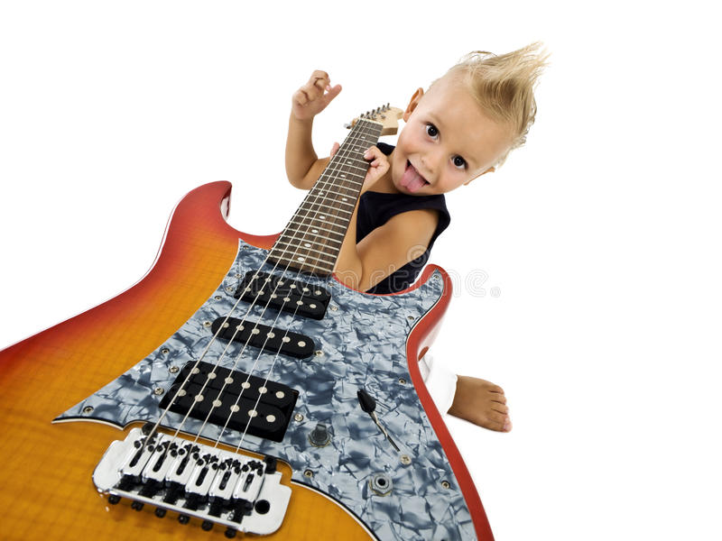 Happy kid with a guitar. Happy kid with electric guitar royalty free stock photos