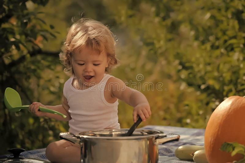 Happy kid having fun. Funny baby boy with vegetables royalty free stock photos