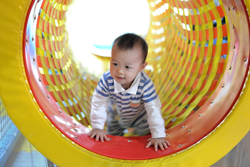 Happy kid having fun on playground. In game zone stock photography