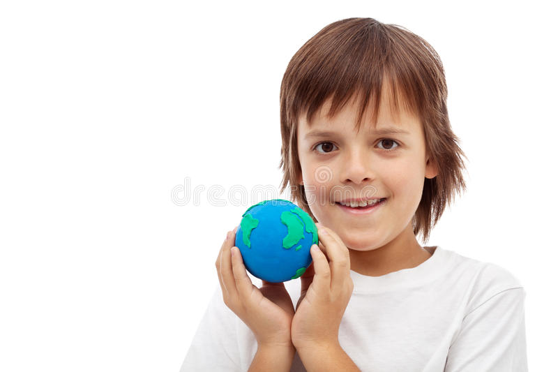 Happy kid holding earth globe made of clay. Ecology concept, isolated royalty free stock photos