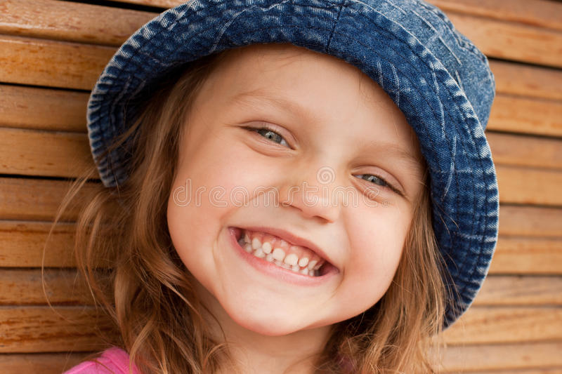 Happy kid in jeans hat royalty free stock image