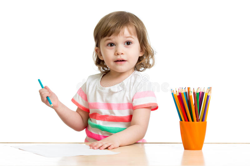 Happy kid little girl drawing with pencils in preschool royalty free stock images