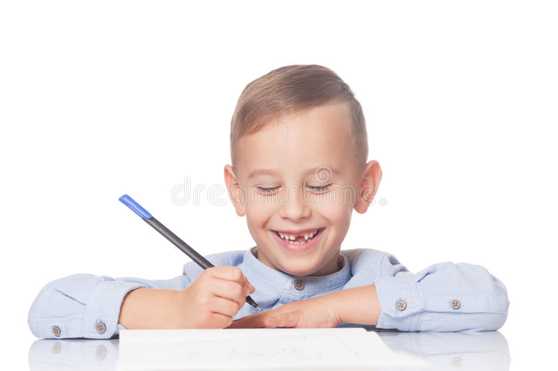 Download Happy kid with a pen stock image. Image of elementary - 79674533