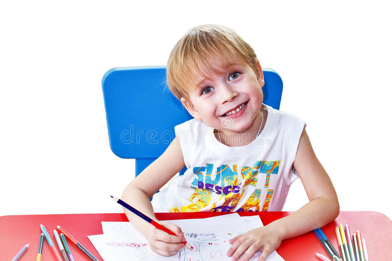 Happy kid with pencils stock images
