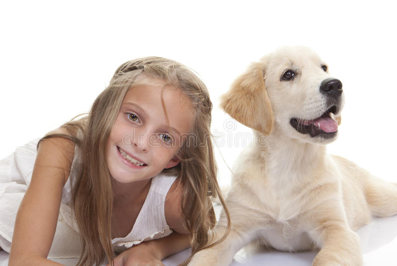 Happy kid with pet pup dog. Happy kid with pet pup golden labrador dog royalty free stock image