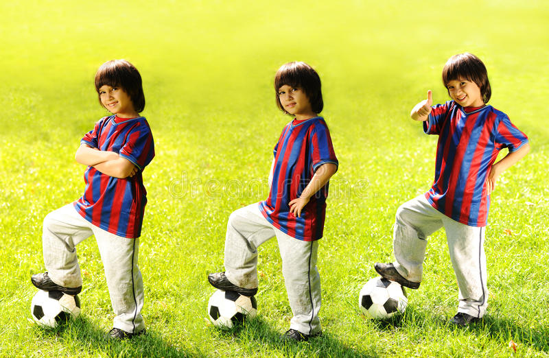 Happy kid playing football in a park royalty free stock photos
