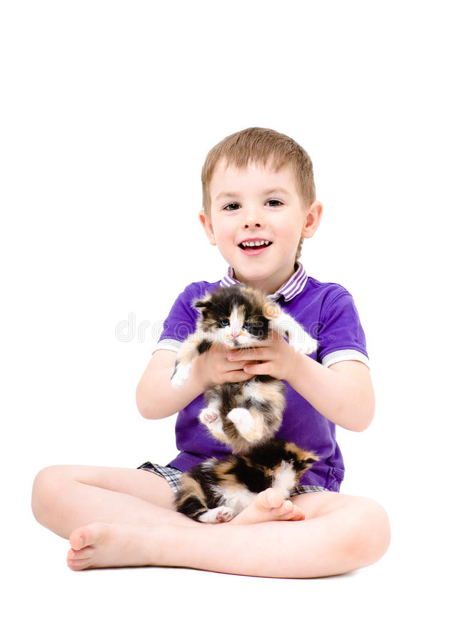 Happy kid playing with kittens. Isolated on white background stock photos