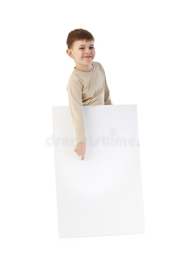 Download Happy Kid Pointing To Blank Sheet Royalty Free Stock Photography - Image: 20659897