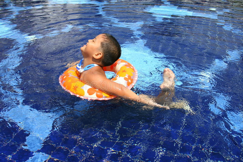 Happy kid in the pool. Happy kid in the swimming pool stock image