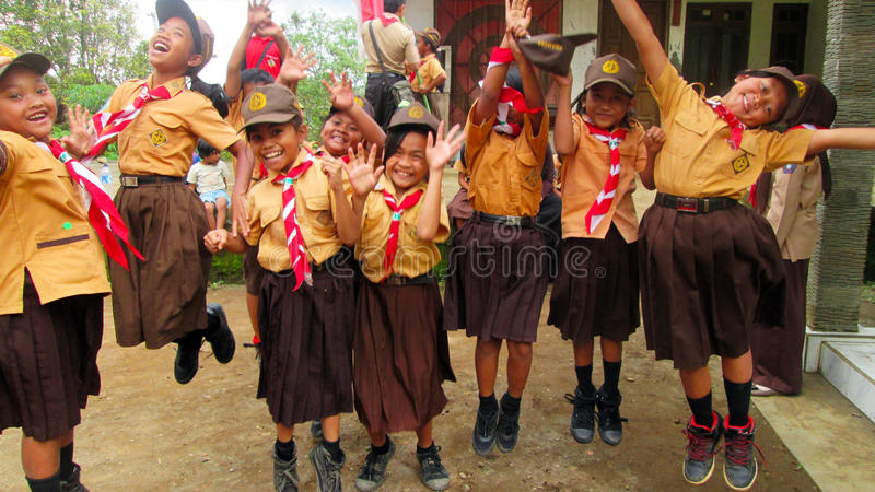 Happy kid scout jump stock photo