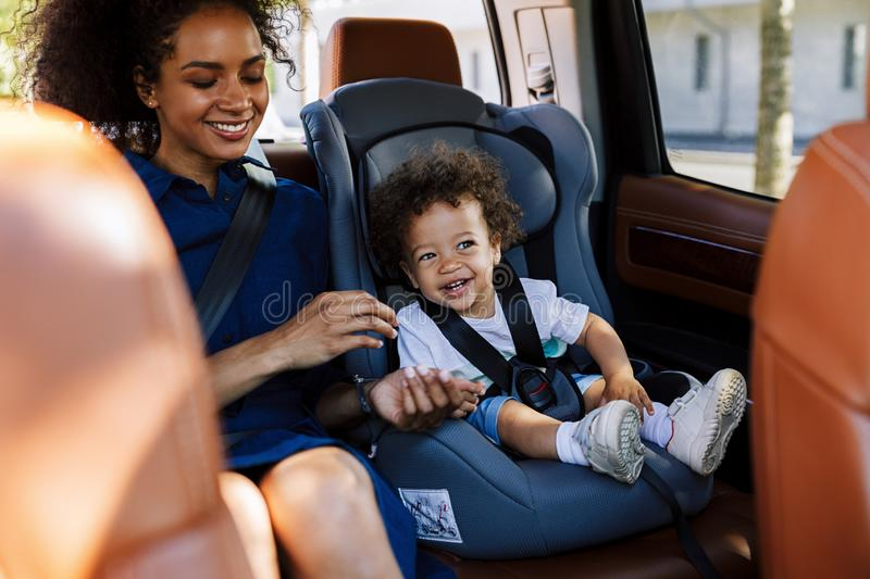 Happy kid sitting on a backseat stock images