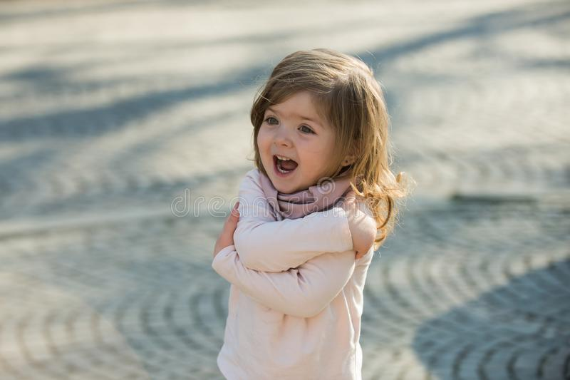 Happy kid smile with hug hand gesture on sunny day royalty free stock images