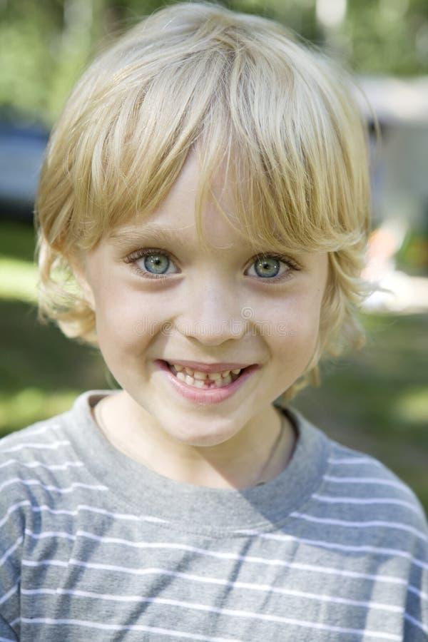 Happy kid smiling. stock image