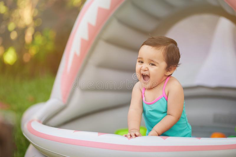 Happy kid in swimming pool royalty free stock photography